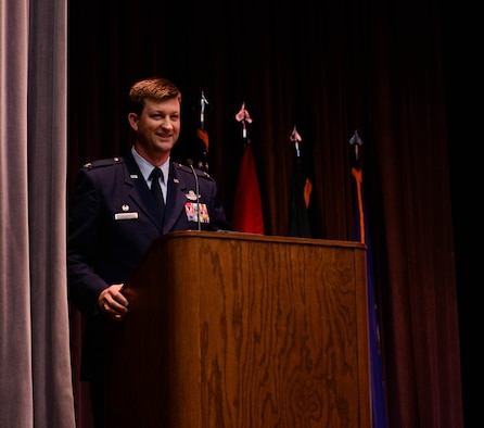 Col. Clinton ZumBrunnen, 437th Airlift Wing commander at Joint Base Charleston, South Carolina, gives a speech at the graduation ceremony of Specialized Undergraduate Pilot Training Class 20-03 Nov. 15, 2019, at Columbus Air Force Base, Miss. During his speech, he told the graduates a story about retired U.S. Army Staff Sgt. Dan Powers, a former squadron leader of the 118th Military Police Company, and how an aircrew's skillful tactics helped save his life. (U.S. Air Force photo by Airman Davis Donaldson)