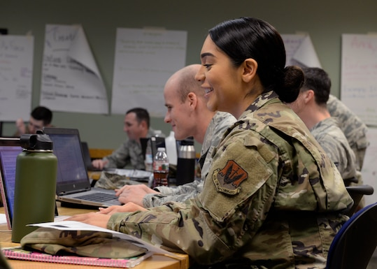 A photo of Airmen sitting in desks during a Airmen Leadership School class