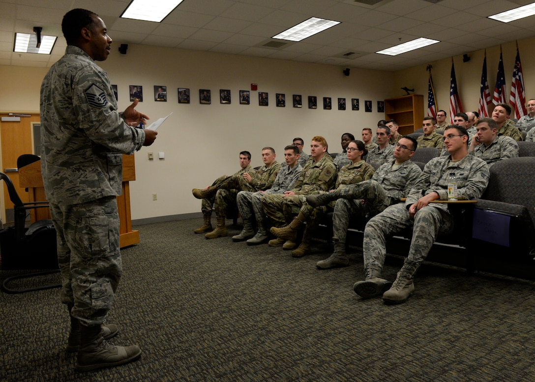 A photo of a senior non-commissioned officer addressing an Airmen Leadership School class.