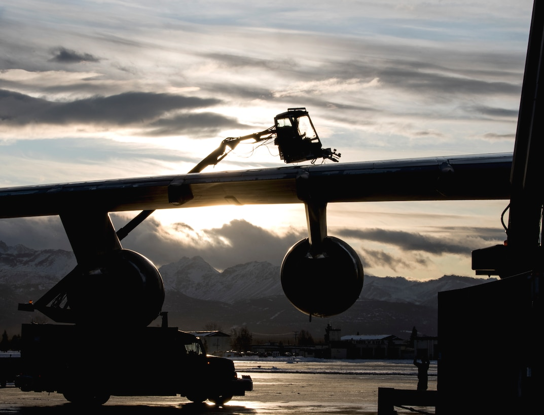 U.S. Air Force Staff Sgt. Damien Sloan, 821st Contingency Response Squadron, contingency response maintenance craftsman assigned to Travis Air Force Base, Calif., operates de-icing equipment on a C-5M Super Galaxy assigned to Travis during cold weather aircraft maintenance procedures training at Joint Base Elmendorf-Richardson, Alaska, Nov. 20, 2019. The training prepared Airmen to operate in arctic environments.