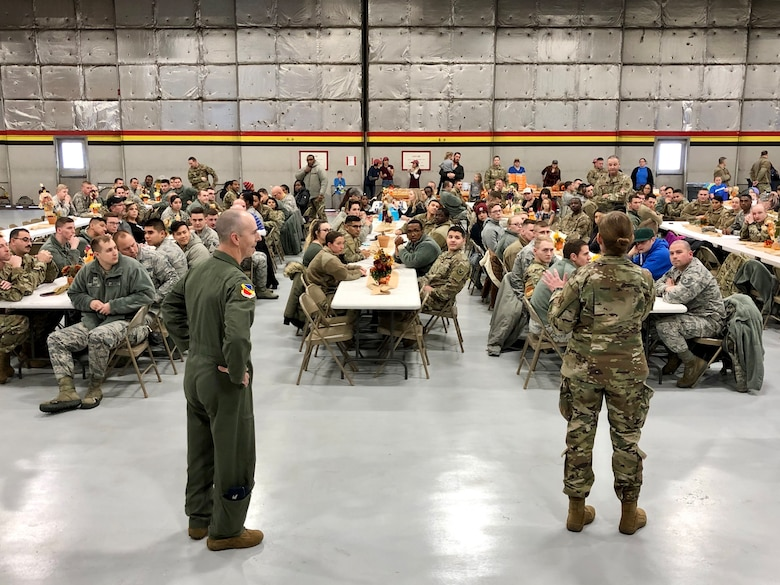 Col. Gina Sabric, 419th Fighter Wing commander, and Col. Steven Behmer, 388th FW commander, greet Airmen before a huge feast Nov. 27