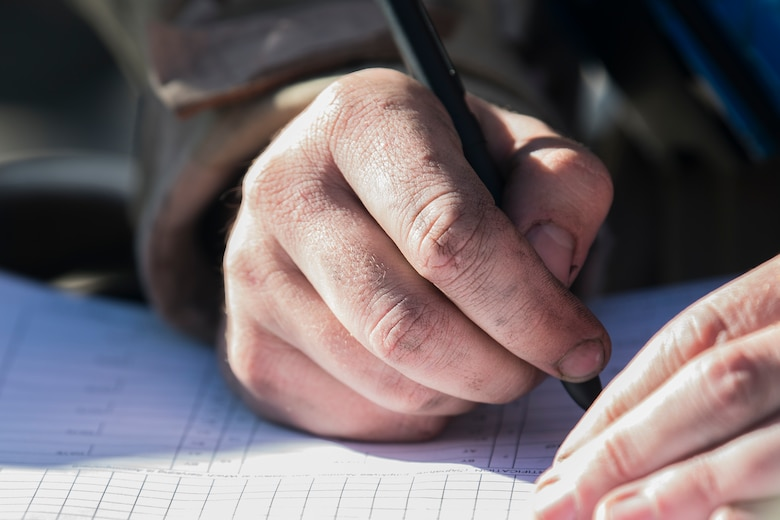 A Cannon Airman fills out paperwork on the flightline during maintenance on a CV-22 Osprey during an Operational Readiness Assessment at Cannon Air Force Base, N.M., Nov. 20, 2019. Cannon has participated in three operational readiness exercises to prepare themselves for the assessment from Air Force Special Operations Command. (U.S. Air Force photo by Senior Airman Vernon R. Walter III)