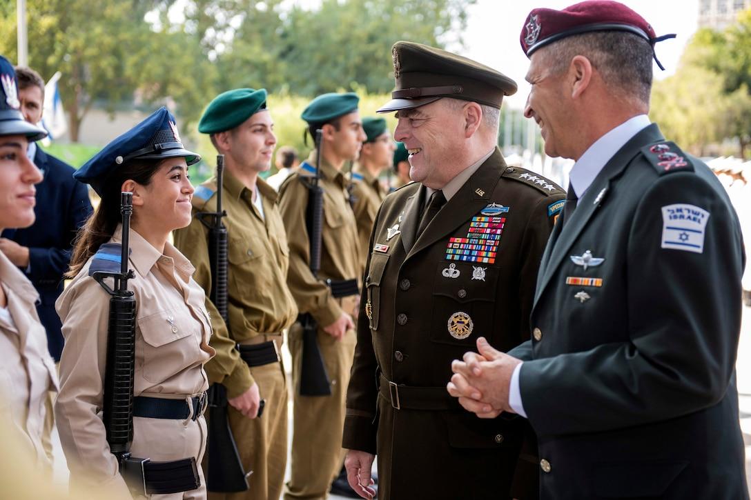 Two military leaders speak to troops.