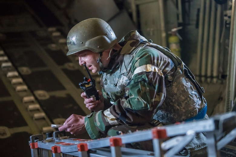 Master Sgt. Austen Martel, 27th Special Operations Aircraft Maintenance Squadron crew chief, calls in that his team has sustained injuries from a simulated sniper attack during an Operational Readiness Assessment at Cannon Air Force Base, N.M., Nov. 20, 2019. Teams were graded on their ability to perform the proper actions in response to various scenarios. (U.S. Air Force photo by Senior Airman Vernon R. Walter III)