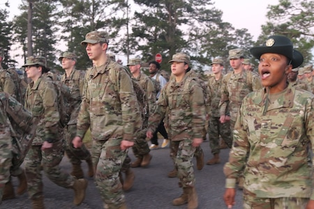 Drill Sgt. Ashley Gilbert leads her trainees in cadence during their morning march to the dining facility for breakfast at Camp Shelby Joint Force Training Center, Nov. 16, 2019, during Spartan Forge Spartan Forge is an annual event conducted by Mississippi Army National Guard Recruiting and Retention Battalion, Bravo Company.