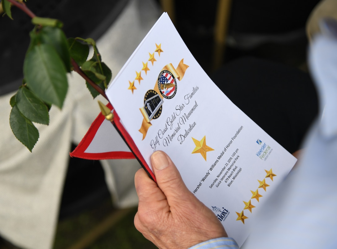 Ashton Belcher, Gold Star family member, holds an event program during the Gold Star Families Memorial Monument dedication ceremony at Guice Veterans Memorial Park in Biloxi, Mississippi, Nov. 23, 2019. The monument honors families of service men and women who sacrificed their lives while serving in the military. (U.S. Air Force photo by Kemberly Groue)