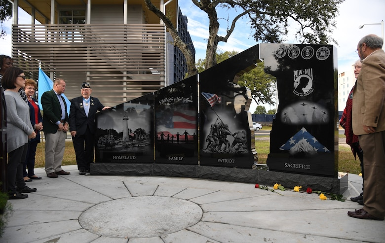 The 58th Gold Star Families Memorial Monument is unveiled during a dedication ceremony at Guice Veterans Memorial Park in Biloxi, Mississippi, Nov. 23, 2019. The monument honors families of service men and women who sacrificed their lives while serving in the military. (U.S. Air Force photo by Kemberly Groue)