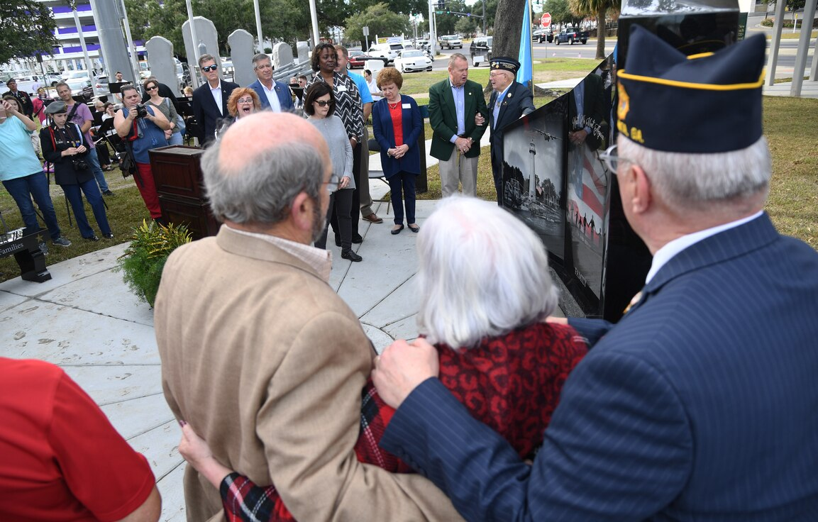 Gold Star family members, local community members and Keesler Airmen attend the Gold Star Families Memorial Monument dedication ceremony at Guice Veterans Memorial Park in Biloxi, Mississippi, Nov. 23, 2019. The monument honors families of service men and women who sacrificed their lives while serving in the military. (U.S. Air Force photo by Kemberly Groue)