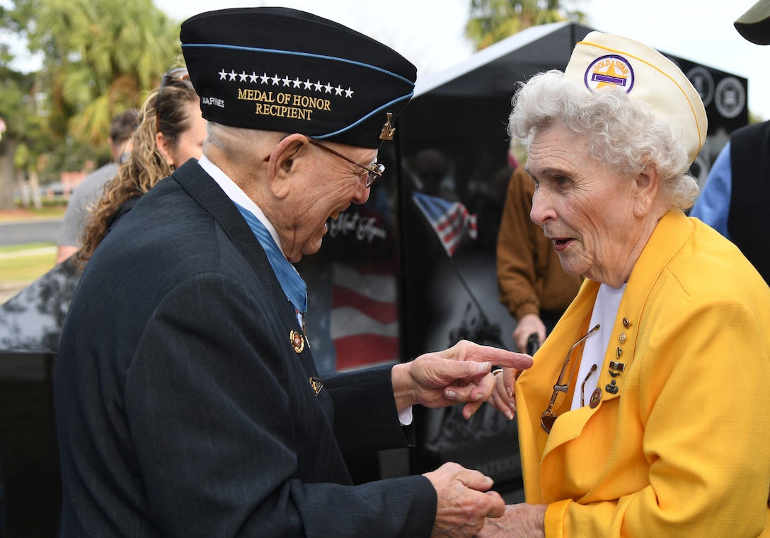 "U.S. Marine retired Warrant Officer Hershel ""Woody"" Williams, World War II Medal of Honor recipient, speaks with Emily Crowder, spouse of U.S. Army retired Maj. Albert Crowder, during the Gold Star Families Memorial Monument dedication ceremony at Guice Veterans Memorial Park in Biloxi, Mississippi, Nov. 23, 2019. The monument honors families of service men and women who sacrificed their lives while serving in the military. (U.S. Air Force photo by Kemberly Groue)"