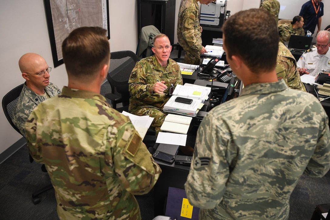 Col. Brian Kehl, 50th Mission Support Group commander, coordinates with various agencies during emergency operations in exercise Opinicus Vista 19-3 at Schriever Air Force Base, Colorado, Nov. 19, 2019.