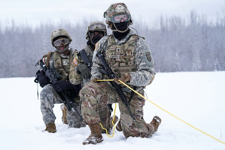 Spc. Eric Stidham assigned to Headquarters and Headquarters Company, 6th Brigade Engineer Battalion (Airborne), 4th Infantry Brigade Combat Team (Airborne), 25th Infantry Division, U.S. Army Alaska, trains with fellow Soldiers and aviators from the Alaska Army National Guard at Neibhur Drop Zone, Nov. 26, 2019, to hone their life-saving and Medevac hoist skills for the paratroopers' upcoming rotation to the Joint Readiness Training Center at Fort Polk, La.