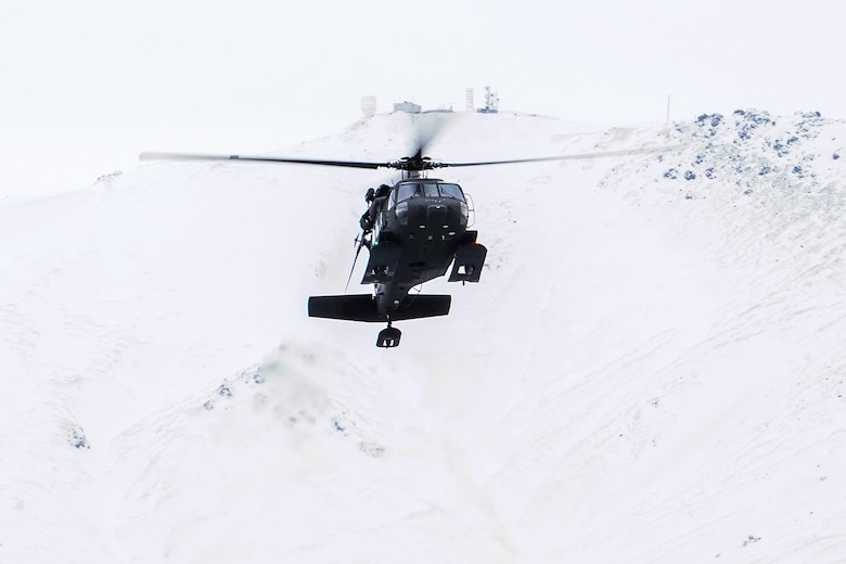 A UH-60 Black Hawk helicopter from the Alaska Army National Guard approaches Neibhur Drop Zone, Nov. 26, 2019, to assist Soldiers assigned to the 6th Brigade Engineer Battalion (Airborne), 4th Infantry Brigade Combat Team (Airborne), 25th Infantry Division, U.S. Army Alaska, in honing their life-saving and Medevac hoist skills for the paratroopers' upcoming rotation to the Joint Readiness Training Center at Fort Polk, La.