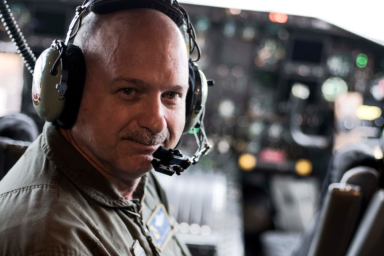 Chief Master Sgt. Terry Studstill, 700th Airlift Squadron flight engineer superintendent, poses for a photo in a C-130H3 Hercules at Dobbins Air Reserve Base, Ga. on Nov. 22, 2019. A couple days later, he reached 10,000 flight hours - a major accomplishment for aviators. (U.S. Air Force photo/Tech. Sgt. Andrew Park)