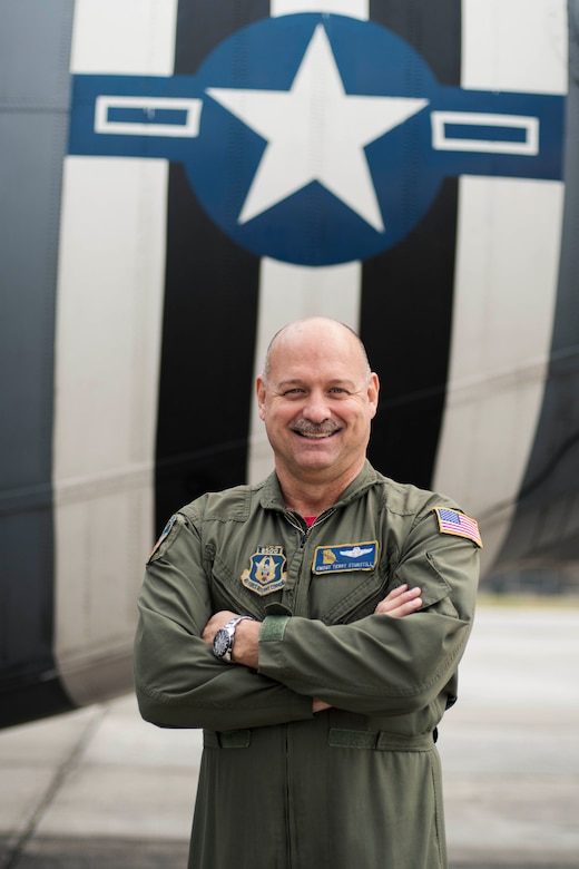 Chief Master Sgt. Terry Studstill, 700th Airlift Squadron flight engineer superintendent, poses for a photo outside a C-130H3 Hercules at Dobbins Air Reserve Base, Ga. on Nov. 22, 2019. A couple days later, he reached 10,000 flight hours - a major accomplishment for aviators. (U.S. Air Force photo/Tech. Sgt. Andrew Park)
