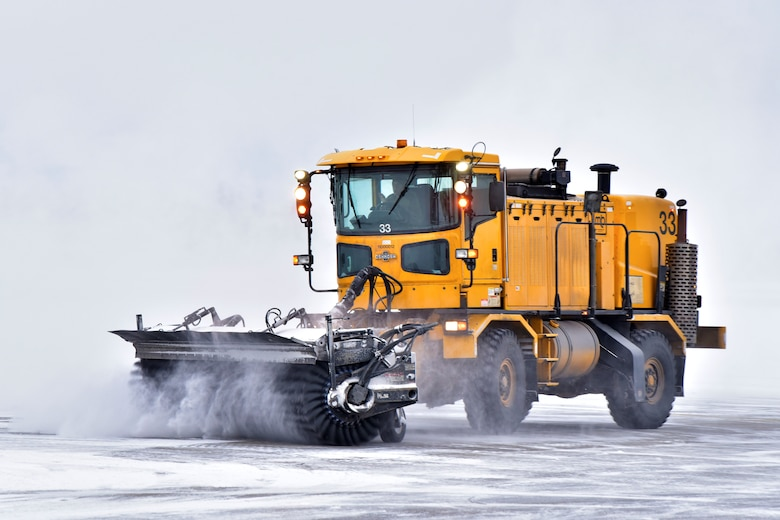 A 354th Civil Engineer Squadron pavements and construction equipment operator clears snow from the flight line at Eielson Air Force Base, Alaska, Nov. 26, 2019. To completely clear one inch of snow off of the runway, 354 CES Airmen have to move approximately 495,000 pounds of snow. (U.S. Air Force photo by Senior Airman Beaux Hebert)
