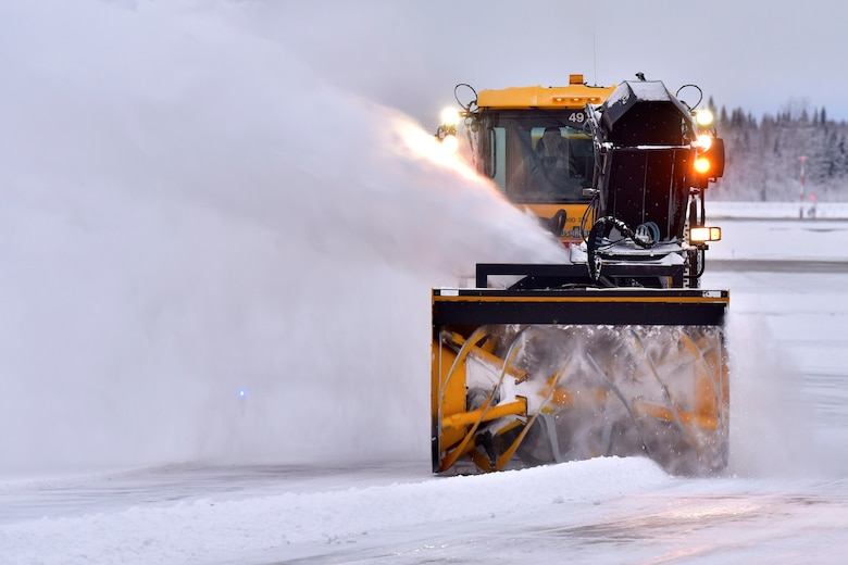 A 354th Civil Engineer Squadron pavements and construction equipment operator removes snow from the flight line at Eielson Air Force Base, Alaska, Nov. 26, 2019.  The runway at Eielson is always active, and therefore must remain free of debris at all times. (U.S. Air Force photo by Senior Airman Beaux Hebert)