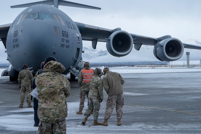 Airmen from Travis Air Force Base, Calif., and Joint Base Elmendorf-Richardson, get ready for cold weather aircraft maintenance procedures training at JBER, Alaska, Nov. 19, 2019. The training prepared Airmen to operate in arctic environments.