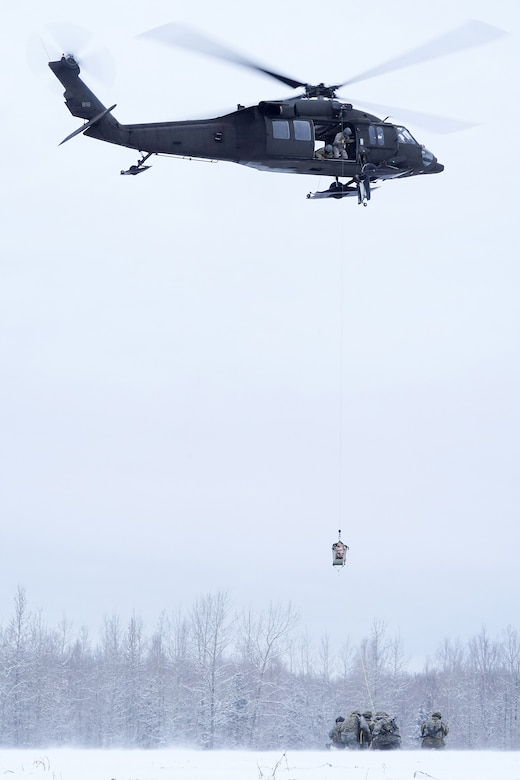 Alaska Army National Guard aviators hoist a simulated casualty with a UH-60 Black Hawk helicopter on Neibhur Drop Zone, Nov. 26, 2019, while assisting Soldiers from the 6th Brigade Engineer Battalion (Airborne), 4th Infantry Brigade Combat Team (Airborne), 25th Infantry Division, U.S. Army Alaska, honing their life-saving and Medevac hoist skills for the paratroopers' upcoming rotation to the Joint Readiness Training Center at Fort Polk, La.