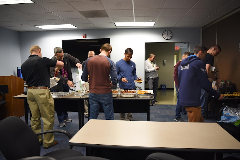 Instructor pilots, RAPCON and tower controllers from Columbus Air Force Base eating a catered lunch Nov. 22, 2019, at the Memphis Center, Tenn. All trainees and certified controllers must pass monthly proficiency tests that include items directed from the FAA and Headquarters Air Education and Training Command. (U.S. Air Force photo by Airmen 1st Class Jake Jacobsen)