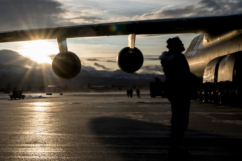 U.S. Air Force Staff Sgt. Damien Sloan, 821st Contingency Response Squadron, contingency response maintenance craftsman assigned to Travis Air Force Base, Calif., conducts de-icing training on a C-5M Super Galaxy assigned to Travis during cold weather aircraft maintenance procedures training at Joint Base Elmendorf-Richardson, Alaska, Nov. 20, 2019. The training prepared Airmen to operate in arctic environments.