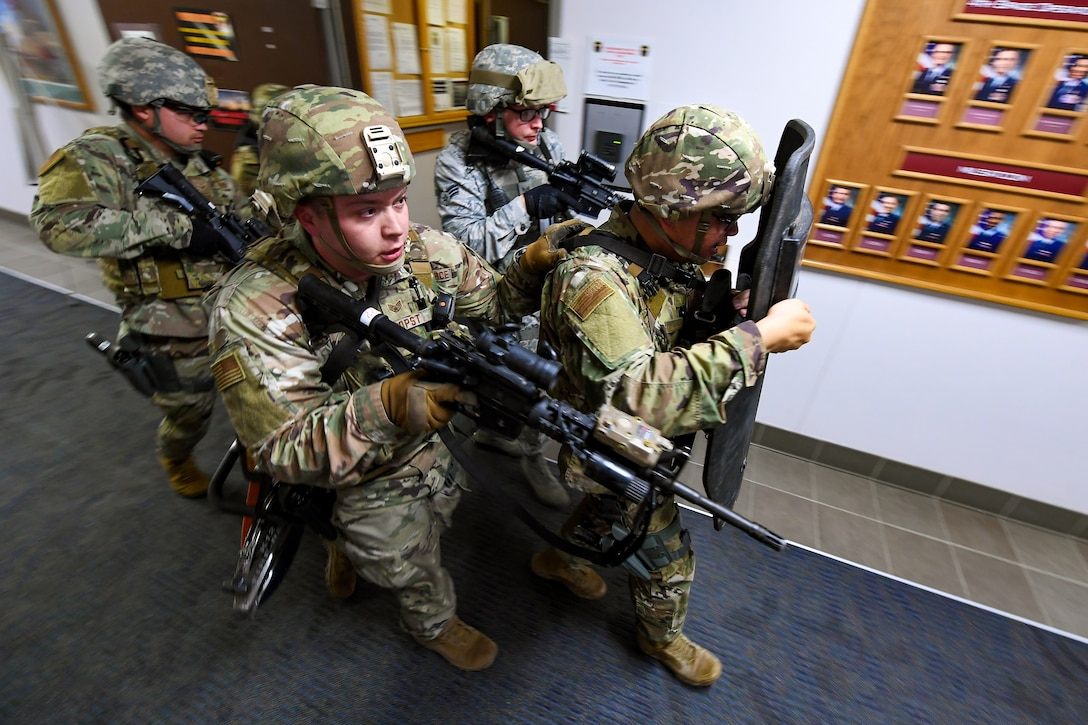 Members of the 50th Security Forces Squadron team line up in a diamond formation behind a crisis response shield during an active-shooter exercise on Schriever Air Force Base.