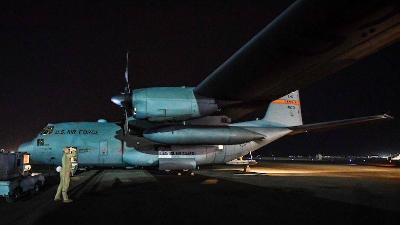 C-130 transports cargo between Kuwait and Iraq.
