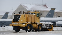 A member the 185th Air Refueling Wing snow removal team clears snow on the ramp area at the Sioux City, Iowa, base Air Guard unit on Nov. 27, 2019.