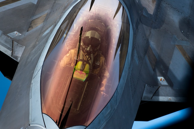 A U.S. Air Force F-22 Raptor is refueled by a 28th Expeditionary Air Refueling Squadron KC-135 Stratotanker during a mission in the U.S. Central Command area of operations, Oct. 25, 2019. The Raptor plays a key role in U.S. Air Forces Central Command operations by maintaining constant readiness in support of air operations, providing deterrence and stability, and bolstering the mission efforts of coalition partners. (U.S. Air Force photo by Master Sgt. Russ Scalf)