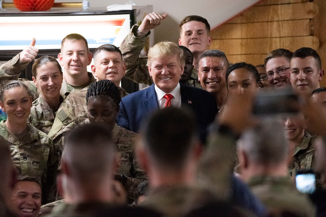 President Donald J. Trump poses for a photo with troops.