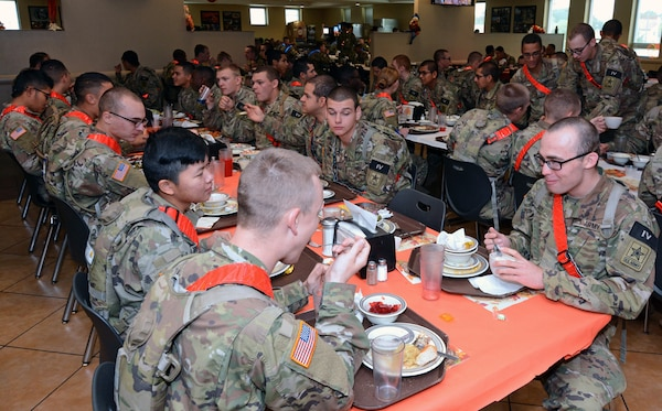 Maj. Gen. Patrick D. Sargent and Command Sgt. Maj. Buck O'Neal, along with other U.S. Army Medical Center of Excellence leaders, served Thanksgiving luncheon to Soldiers at the Slagel Dinning Facility at Joint Base San Antonio-Fort Sam Houston Nov. 28. The time-honored military tradition of senior leaders serving Thanksgiving Day dinner to Soldiers is an example of how military service is like an extended family. For many, this is their first time away from home and their first holiday away from home.