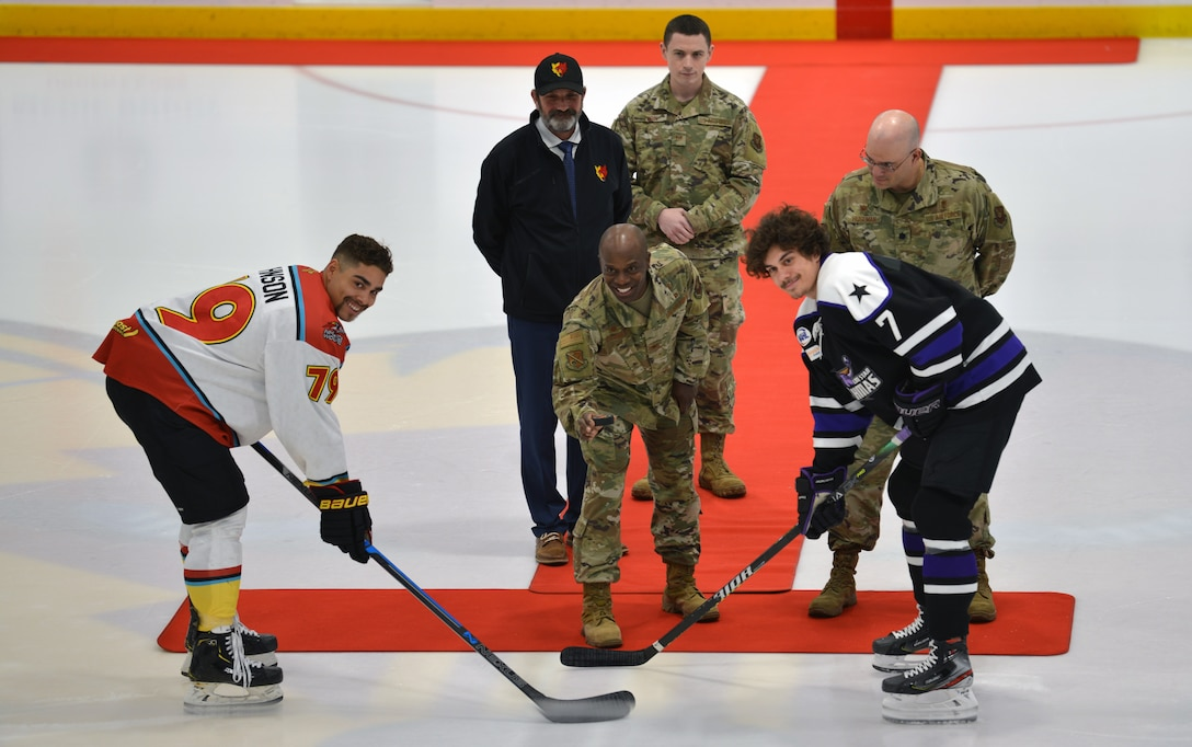 Air Force Col. Gregory Coleman poses for a photo before dropping the ceremonial first puck