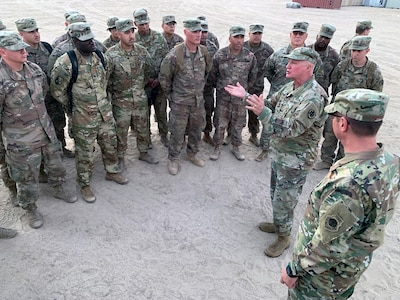 Army Brig. Gen. Kenneth Brandt, National Guard Bureau chaplain, talks with service members during Thanksgiving troop visits, Kuwait, Nov. 27, 2019. This image was acquired using a cellular phone.