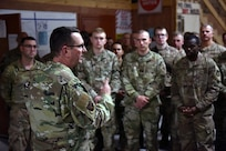 Air Force Gen. Joseph Lengyel, chief, National Guard Bureau, talks with troops during Thanksgiving holiday visits to units in three countries, Kuwait, Nov. 27, 2019.