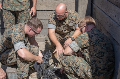 U.S. Marines with Special Purpose Marine Air-Ground Task Force-Crisis Response-Africa 19.2 and 20.1, Marine Forces Europe and Africa, assess the blast damage during an advanced-manufacturing charge range on Naval Station Rota, Spain, Sept. 24, 2019
