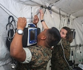 U.S. Navy Sailors with Special Purpose Marine Air-Ground Task Force-Crisis Response-Africa 20.1, Marine Forces Europe and Africa, set up a shock trauma platoon in preparation of SPMAGTF-CR-AF 20.1 at Naval Air Station Sigonella, Italy Sept. 26, 2019