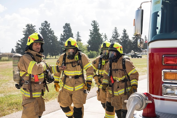 """Firefighters from the 39th Civil Engineer Squadron conduct live-fire training May 8, 2019, at Incirlik Air Base, Turkey. Incirlik Firefighters are slated to celebrate Fire Prevention Week from Oct. 6-12, 2019 and this year's theme is """"Not Every Hero Wears a Cape. Plan and Practice Your Escape."""" (U.S. Air Force photo by Staff Sgt. Ceaira Tinsley)"""