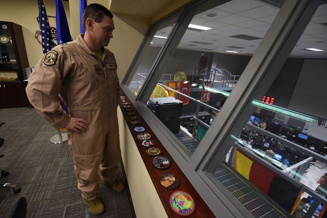 Maj. Gen. Saltzman looks down at the COD floor.