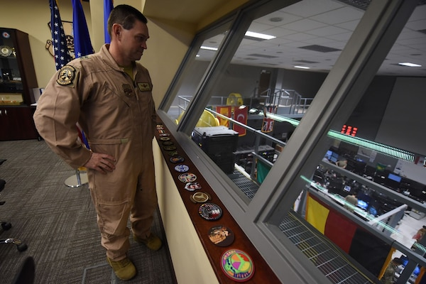 Maj. Gen. Saltzman looks down at the COD floor.