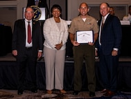 U.S. Marine Corps Gunnery Sgt. Brian R. Stacey, an administrative chief with 4th Marine Logistics Group, receives an award during the Navy League Military Appreciation Luncheon, New Orleans, Sept. 27, 2019. The Navy League awarded Stacey for being the most outstanding staff noncommissioned officer of 4th MLG. (U.S. Marine Corps photo by Lance Cpl. Jose Gonzalez)