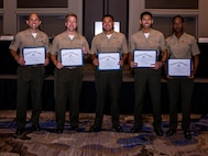 U.S. Marines with Marine Forces Reserve pose for a photo during the Navy League Military Appreciation Luncheon, New Orleans, Sept. 27, 2019. The Navy League awarded the Marines for being the most outstanding noncommissioned and staff NCO of their command. (U.S. Marine Corps photo by Lance Cpl. Jose Gonzalez)