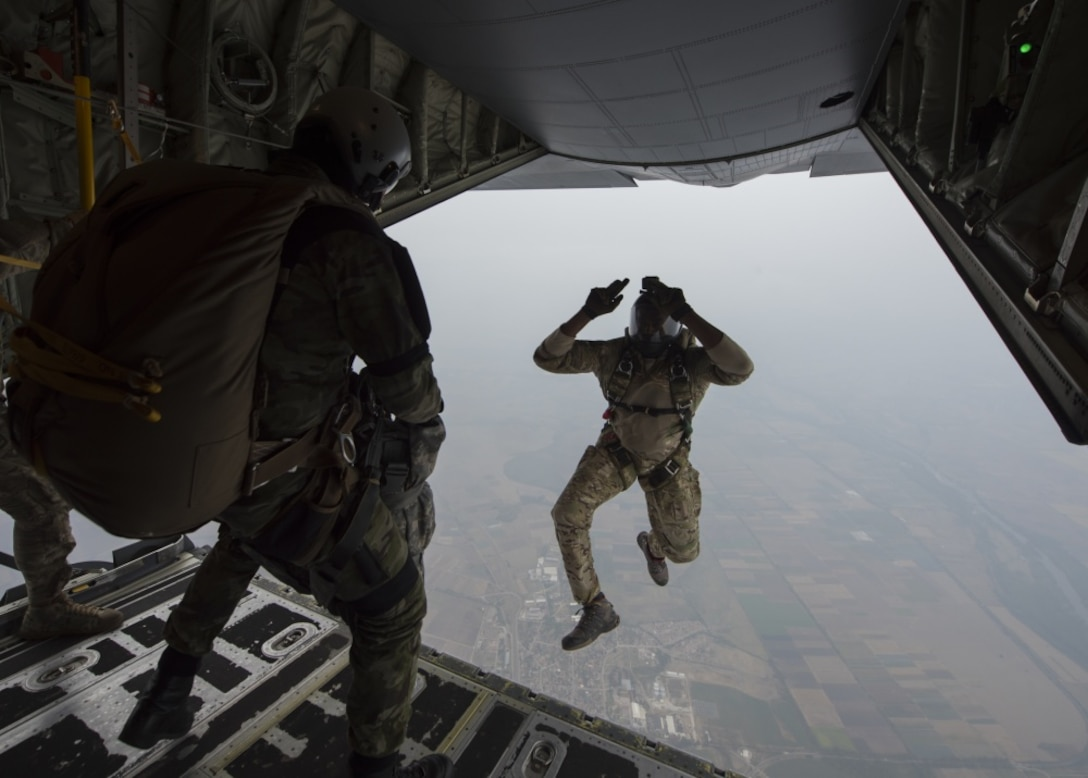 A U.S. military jumpmaster models an aircraft exit for a student from the Bulgarian 68th Special Forces Brigade during a military free-fall course in Plovdiv, Bulgaria, Sept. 24, 2019. The military free-fall course was a central focus for Thracian Fall and the 37th Airlift Squadron provided primary aircraft support using their C-130J Super Hercules. (U.S. Air Force photo by Staff Sgt. Kirsten Brandes)