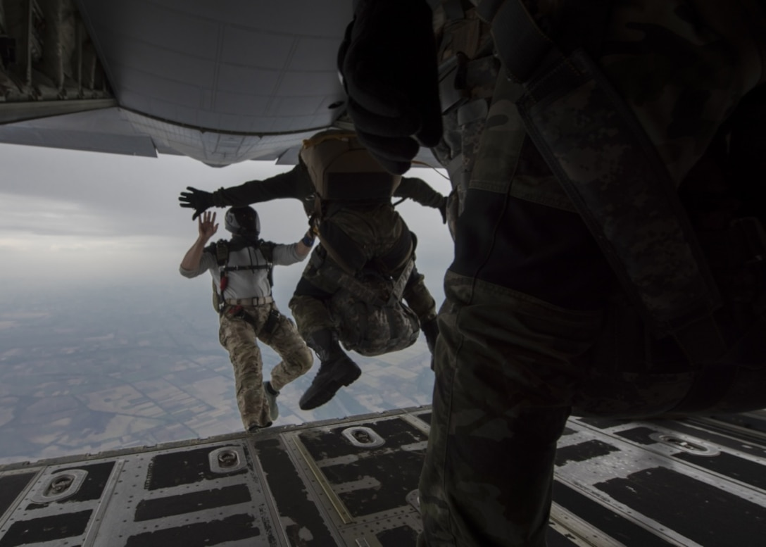A U.S. military jumpmaster jumps with a student from the Bulgarian 68th Special Forces Brigade during a military free-fall course in Plovdiv, Bulgaria, Sept. 24, 2019. The military free-fall course was a central focus for Thracian Fall and the 37th Airlift Squadron provided primary aircraft support using their C-130J Super Hercules. (U.S. Air Force photo by Staff Sgt. Kirsten Brandes)