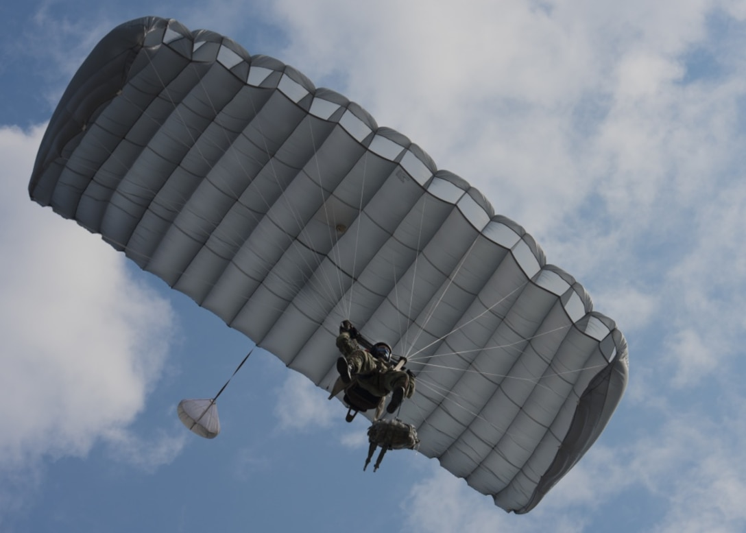 A jumper from the Bulgarian 68th Special Forces Brigade parachutes into Cheshnegirovo drop zone in Plovdiv, Bulgaria, Sept. 26, 2019. The military free-fall course will allow members of the 68th SFB to qualify on a new type of parachute. (U.S. Air Force photo by Staff Sgt. Kirsten Brandes)