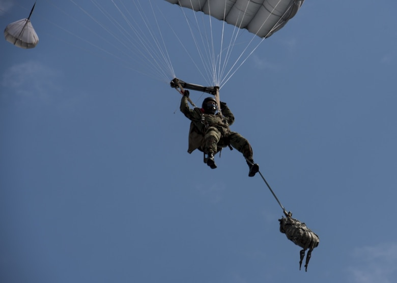 A jumper assigned to Bulgaria's 68th Special Forces Brigade parachutes into Cheshnegirovo drop zone in Plovdiv, Bulgaria, Sept. 26, 2019. Bulgarian 68th SFB members who complete the military free-fall course are expected to complete jumps with bags full of gear as well as rifles. (U.S. Air Force photo by Staff Sgt. Kirsten Brandes)