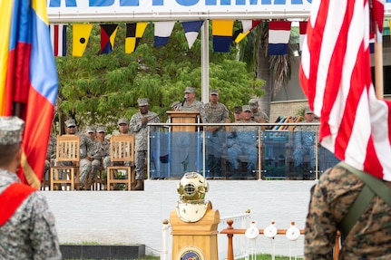Military personnel on a stage for a ceremony.