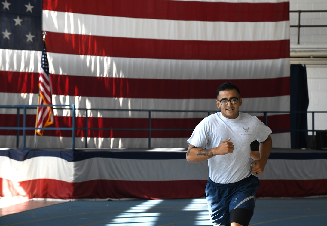Senior Airman Daniel De La Torre, a 28th Security Forces Squadron combat arms scheduler, competes in the 1,000-meter run for the German Armed Forces Proficiency Badge at the Pride Hangar on Ellsworth Air Force Base, S.D., Sept. 21, 2019. Participants had to meet specific standards in order to be awarded a bronze, silver or gold badge.  (U.S. Air Force photo by Airman 1st Class Christina Bennett)