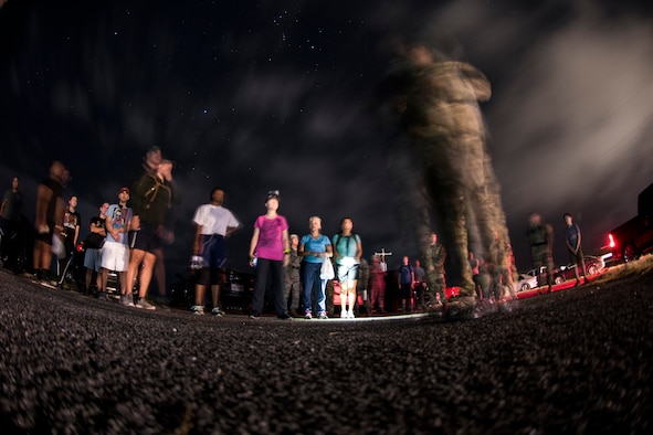 "47th Flying Training Wing Command Chief Master Sgt. Robert Zackery III talks to a crowd of Airmen before beginning the 5-kilometer ""Walk with the Chief"" ruck at Laughlin Air Force Base, Texas, Sept. 30, 2019. Approximately 30 members of Team XL came out in the early hours on Monday morning to increase their deployment readiness and have an opportunity to connect with Zackery in an informal setting. (U.S. Air Force photo by Senior Airman Marco A. Gomez)"