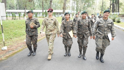 A group of Guatemalan military women walk together.