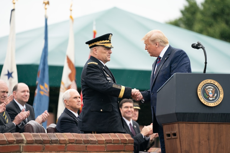 President Donald J. Trump shakes hands with Army Gen. Mark A. Milley upon the latter's assumption of office as the 20th chairman of the Joint Chiefs of Staff during a ceremony at Joint Base Myer-Henderson Hall, Virginia, Sept. 30, 2019.