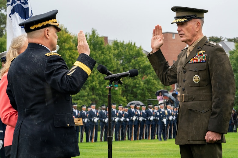 Marine Corps Gen. Joe Dunford, the outgoing chairman of the Joint Chiefs of Staff, swears in his successor, Army Gen. Mark A. Milley, during an armed forces welcome ceremony at Joint Base Myer-Henderson Hall, Virginia, Sept. 30, 2019.
